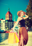 Fashionable woman walking with shopping bags Royalty Free Stock Images