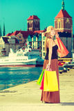 Fashionable woman walking with shopping bags Royalty Free Stock Photo
