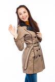 Fashionable woman waving her hand Stock Photography