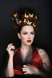 Fashionable Woman Wearing High End Head Piece Stock Photo