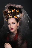 Fashionable Woman Wearing High End Head Piece Royalty Free Stock Image