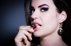 Fashionable woman wearing jewelry and makeup Stock Photography