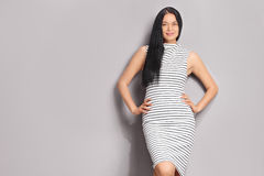 Fashionable woman wearing a striped dress Royalty Free Stock Photography