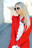 Fashionable woman wearing sunglasses outdoors Stock Photo