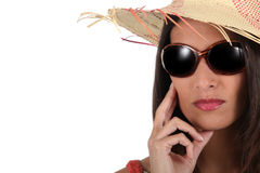 Fashionable woman. Wearing sunglasses and straw hat Royalty Free Stock Photos