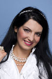Fashionable woman in white with pearls Stock Image