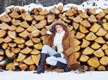 Fashionable woman and winter clothes - rural scene Stock Images