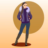 The fashionable woman in a winter jacket. And in boots on heels Stock Image