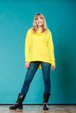 Fashionable woman in yellow blouse winter boots Stock Images