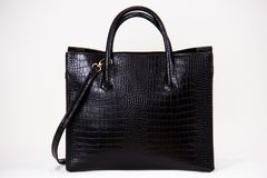 Fashionable women bag. Fashionable black lether women bag with texture Stock Images