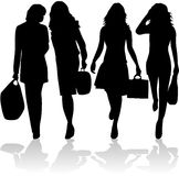 Fashionable women going shopping Stock Images