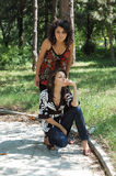Fashionable women in park Royalty Free Stock Images