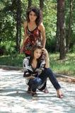 Fashionable women in park Stock Photos