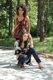 Fashionable women in park Stock Image