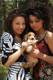 Fashionable women with pet dog Stock Image