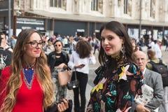 Fashionable women posing during Milan Fashion Week Royalty Free Stock Images