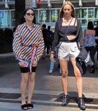 MILAN, ITALY -JUNE 16, 2018: Fashionable women posing in the street before MARNI fashion show, during Milan Fashion Week stock photo