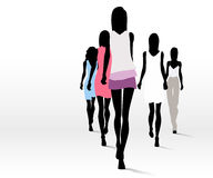 Fashionable women on runway royalty free illustration