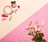 Fashionable Women`s Cosmetics and Accessories. Falt Lay. Nail Polish and blush. Jewelry and Rings. A bouquet of flowers. Pink roses Stock Photography
