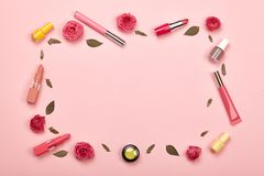 Fashionable Women`s Cosmetics and Accessories. Falt Lay. Nail Polish and Lipstick. Beautiful Roses Flower. Make Up Cosmetic items Top View Stock Image