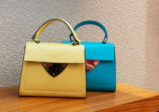 Woman handbag in a showcase of a luxury store. Royalty Free Stock Images
