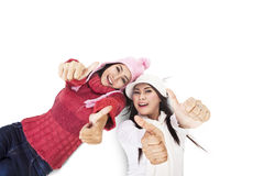 Fashionable women showing thumbs-up Stock Images