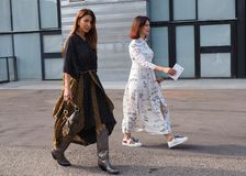 MILAN, Italy: 19 september 2018: Fashionable women in streetstyle outfit. Fashionable women in streetstyle outfit after Alberto Zambelli fashion show during stock photos