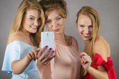 Fashionable women taking selfie Stock Photos