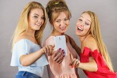 Fashionable women taking selfie royalty free stock image