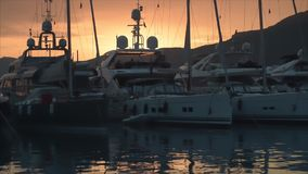 Fashionable yachts at sunset. Fashionable yachts in marine at sunset stock video