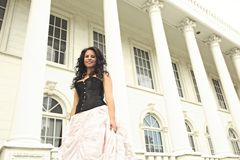 Fashionable Young African American Woman in Front of White Building Royalty Free Stock Images