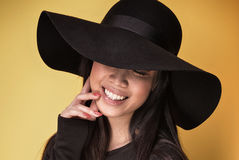 Fashionable young asian girl in hat. Royalty Free Stock Photos