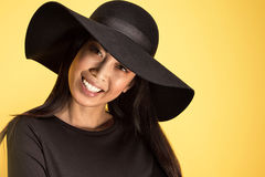 Fashionable young asian girl in hat. Stock Image