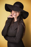 Fashionable young asian girl in hat. Royalty Free Stock Image