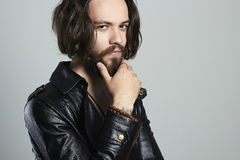Fashionable young bearded man in leather. Hipster.handsome boy Royalty Free Stock Images