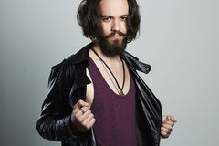 Fashionable young bearded man in leather jacket. Hipster Stock Image