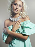 Fashionable young beautiful woman. beauty Blond girl in dress and accessories. Curly hair Royalty Free Stock Image