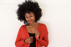 Fashionable young black woman in red sweater smiling Stock Image