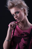 Fashionable young blond woman. With spiky hairstyle, black background Royalty Free Stock Photography