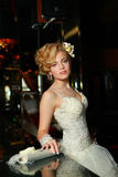 Fashionable young bride in white Royalty Free Stock Image