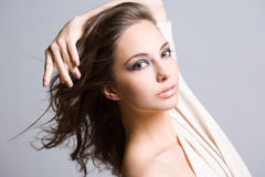 Fashionable young brunette beauty. Royalty Free Stock Photos