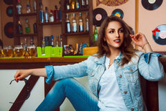 Fashionable young brunette with healthy skin and make up looking Stock Photography