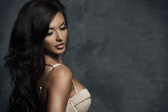 Fashionable young brunette sensual woman Royalty Free Stock Image