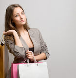 Fashionable young brunette shopper. Royalty Free Stock Photo