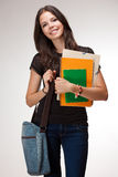 Fashionable young brunette student. Royalty Free Stock Photography