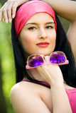 Fashionable young brunette with sunglasses Stock Photography