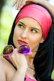 Fashionable young brunette with sunglasses Royalty Free Stock Photos