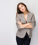 Fashionable young brunette woman. Royalty Free Stock Images