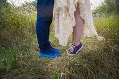Fashionable young couple in sneakers on nature, legs, lifestyle-concept Royalty Free Stock Images