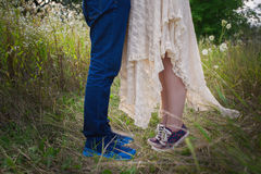 Fashionable young couple in sneakers on nature, legs, lifestyle-concept Stock Photo